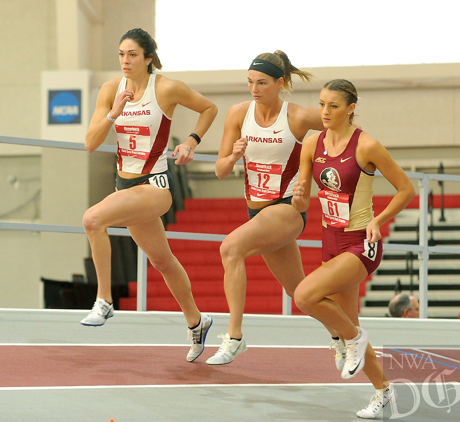 NWA Democrat-Gazette/MICHAEL WOODS &bull; @NWAMICHAELW<br /> University of Arkansas pentathletes Leigh Brown (5) and Alex Gocheenour (12) compete in the 800 meter run Friday, January 29, 2016, during the womens pentathlon at the Razorback Invitational at the Randal Tyson Track Complex in Fayetteville.