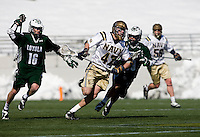 Cooper MacDonnell (16) of Loyola tries to take the ball away from Jay Mann (47) of Navy at the Navy-Marine Corp Memorial Stadium in Annapolis, Maryland.   Loyola defeated Navy, 8-7, in overtime.