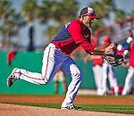 9 March 2014: Washington Nationals utility infielder Jamey Carroll warms up prior to a Spring Training game against the St. Louis Cardinals at Space Coast Stadium in Viera, Florida. The Nationals defeated the Cardinals 11-1 in Grapefruit League play. Mandatory Credit: Ed Wolfstein Photo *** RAW (NEF) Image File Available ***
