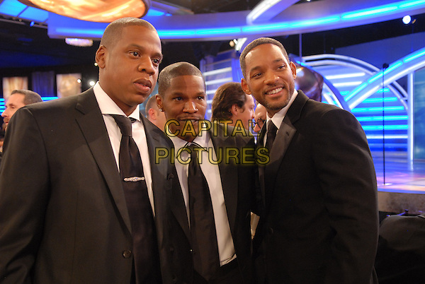 "JAY-Z, JAMIE FOXX & WILL SMITH.Telecast - 64th Annual Golden Globe Awards, Beverly Hills HIlton, Beverly Hills, California, USA..January 15th 2007. .globes half length Jay Z black suit jacket.CAP/AW.Please use accompanying story.Supplied by Capital Pictures.© HFPA"" and ""64th Golden Globe Awards"""