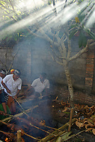 Preparing piglets for ceremony, Ubud area,Bali