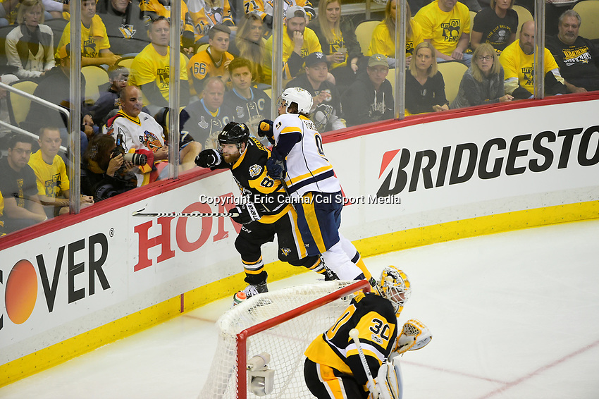 May 31, 2017: Nashville Predators center Filip Forsberg (9) checks Pittsburgh Penguins right wing Phil Kessel (81) during game two of the National Hockey League Stanley Cup Finals between the Nashville Predators  and the Pittsburgh Penguins, held at PPG Paints Arena, in Pittsburgh, PA. The Penguins defeat the Predators 4-1 and lead the series 2-0. Eric Canha/CSM