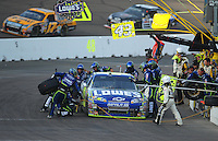 Nov. 9, 2008; Avondale, AZ, USA; NASCAR Sprint Cup Series driver Jimmie Johnson pits during the Checker Auto Parts 500 at Phoenix International Raceway. Mandatory Credit: Mark J. Rebilas-