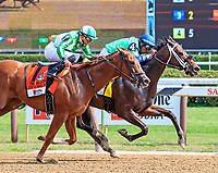 By the Moon (no. 4) wins the Grade 1 Ketel One Ballerina Stakes August 26 at Saratoga Race Course, Saratoga Springs, NY.  The winner, ridden by Rajiv Maragh and trained by  Michelle Nevin,  gamely held off Highway Star and won by a head in the seven furlong race against six opponents.  (Bruce Dudek/Eclipse Sportswire)