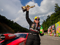 Jun 21, 2015; Bristol, TN, USA; NHRA pro stock driver Erica Enders-Stevens celebrates after winning the Thunder Valley Nationals at Bristol Dragway. Mandatory Credit: Mark J. Rebilas-USA TODAY Sports
