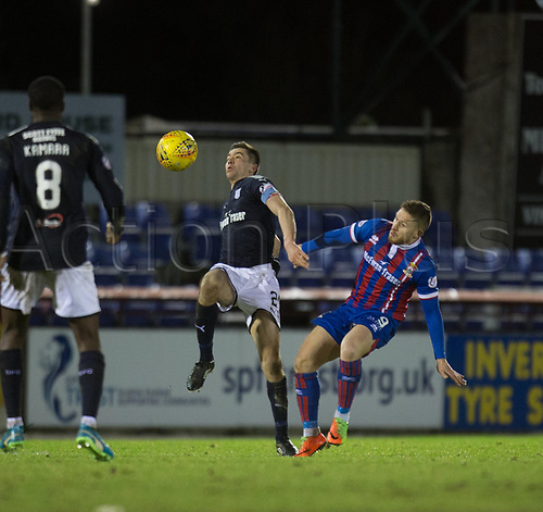 30th January 2018, Tulloch Caledonian Stadium, Inverness, Scotland; Scottish Cup 4th round replay, Inverness Caledonian Thistle versus Dundee; Dundee's Cammy Kerr beas Inverness Caledonian Thistle's John Baird to he ball