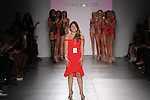 Fashion designer thanks audience for attending her Yandy Swim 2017 collection fashion show on February 14, 2017; at Pier59 Studios during New York Fashion Week Fall Winter 2017.