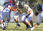 Palos Verdes, CA 10/09/15 - Angel Maya (Peninsula #77), Chris Ghaly (Peninsula #75) and Jose Cordova (Morningside #50) in action during the Morningside - Peninsula varsity football game.  Morning side defeated Peninsula 24-21.