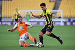 Wellington Phoenix' Liberato Cacace and Brisbane&rsquo;s Eric Bautheac in action during the A League - Wellington Phoenix v Brisbane Roar FC at Westpac Stadium, Wellington, New Zealand on Sunday 25 March 2018.<br /> Photo by Masanori Udagawa. <br /> www.photowellington.photoshelter.com