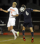 (Worcester Ma 111613)  Belchertown 10, Alexander DeSantis and Medway 6, Connor Benjamin, compete for the header in the first half, during the MIAA Divsion Three Boys Soccer Final between Belchertown High and Medway High, Saturday night at Foley Field in Worcester. (Jim Michaud Photo) For Sunday