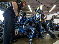 DAYTONA BEACH, FL - JAN 24: Scott Dixon, of New Zealand, exits the car while Ryan Briscoe, of Australia prepares to climb in during driver change practice before Rolex 24 at Daytona at Daytona International Speedway, Daytona Beach, Florida,  January 24, 2020. (Photo by Brian Cleary/BCPix.com)