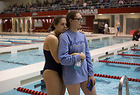 NWA Democrat-Gazette/CHARLIE KAIJO Bentonville West swimmers Haylie Kivisto, 17 and Zoe Tauriainen, 16, (from left) hug during a swim meet, Saturday, February 9, 2019 at the University of Arkansas HYPER pool in Fayetteville.