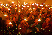 Catholics pray with candles during the vigil for Pope John Paul II, in the Church Quenn of Peace, in Brasilia, Brazil, on Friday, April 1, 2005. The Church Quenn of Peace was built in the month of October of 1991, after second visits of Pope John Paul II to Brazil.  (AP Photo/Eraldo Peres). ***EFE OUT***