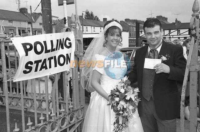 "Newly weds Yvonne Fagan and David Grendon had a double reason to declare ""I do"" Within minutes of exchanging vows in St Peters CHurch in Drogheda, Co.Louth, they took time out to make the short journey to the polling Booth , to cast their votes in the double referendum. Their votes, they revealed, ""ran along the same the-me"" as their big day...Picture shows Yvonne and David going to the Polling Station to vote...PIc Fran Caffrey Newsfile XDrogheda +353(0)-862-500958"