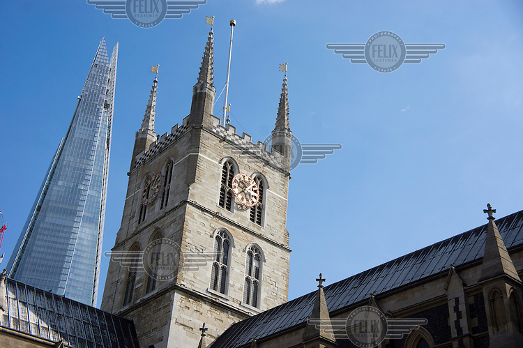 The Shard, Western Europe's tallest building at 310 metres, rises behind Southwark Cathedral in London.