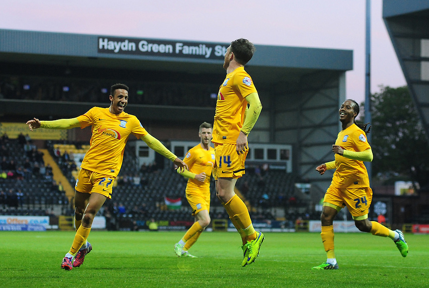 Preston North End's Joe Garner, centre, celebrates scoring his sides second goal with team-mates Callum Robinson, left, and Daniel Johnson<br /> <br /> Photographer Chris Vaughan/CameraSport<br /> <br /> Football - The Football League Sky Bet League One - Notts County v Preston North End - Tuesday 21st April 2015 - Meadow Lane - Nottingham<br /> <br /> &copy; CameraSport - 43 Linden Ave. Countesthorpe. Leicester. England. LE8 5PG - Tel: +44 (0) 116 277 4147 - admin@camerasport.com - www.camerasport.com