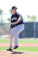 Jonathan Gray #99 of the Colorado Rockies pitches during a Minor League Spring Training Game against the San Francisco Giants at the Colorado Rockies Spring Training Complex on March 18, 2014 in Scottsdale, Arizona. (Larry Goren/Four Seam Images)