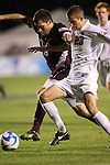14 December 2007: Ohio State's Eric Brunner (23) and Massachusetts' Mark DeSantis (18). The Ohio State University Buckeyes defeated the University of Massachusetts Minutemen 1-0 at SAS Stadium in Cary, North Carolina in a NCAA Division I Mens College Cup semifinal game.