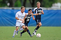 10 September 2011:  FIU's Lucas Di Croce (10) battles Stetson's Kai Eckonrode (9) for the ball in the second half as the FIU Golden Panthers defeated the Stetson University Hatters, 3-2 in the second overtime period, at University Park Stadium in Miami, Florida.
