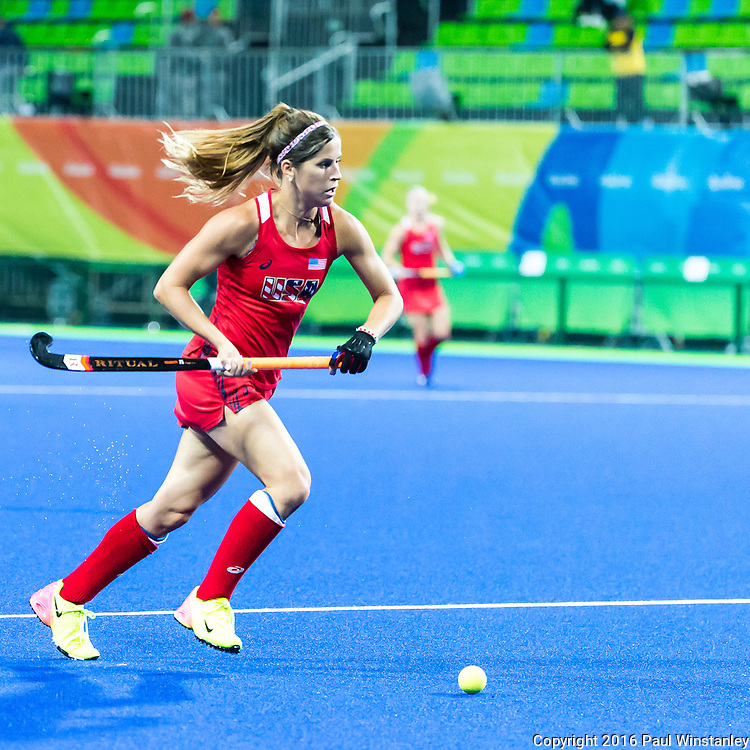 Katie Reinprecht #14 of United States looks to pass during USA vs Japan in a Pool B game at the Rio 2016 Olympics at the Olympic Hockey Centre in Rio de Janeiro, Brazil.