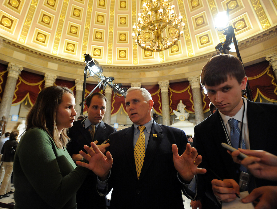 (center) Mike Pence (R-IN) House Republican Conference Chairman, answers media questions from (left to right) Kerry Picket, of the Washington Times, and James Hohmann, of Politico, before the State of the Union address on Wed. Jan. 27, 2010. (Amanda Lucidon)
