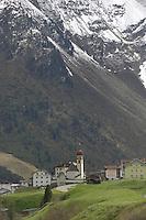 Houses and hotels below snow capped mountain. Vent village, district of Sölden, Tyrol, Tirol, Austria.