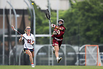 CHAPEL HILL, NC - MAY 12: Elon's Rachel Ramirez (30) passes the ball over Virginia's Besser Dyson (21). The Elon University Phoenix played the University of Virginia Cavaliers on May 12, 2017, at Fetzer Field in Chapel Hill, NC in an NCAA Women's Lacrosse Tournament First Round match. Virginia won the game 11-9.