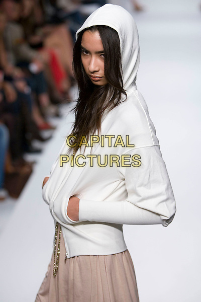 MODEL.Mercedes-Benz Spring 2007 L.A. Fashion Week - Metro 7 - Runway held at Smashbox Studios, Culver City, California, USA, 16 October 2006..half length runway catwalk fashion white hoodie.Ref: ADM/ZL.www.capitalpictures.com.sales@capitalpictures.com.©Zach Lipp/AdMedia/Capital Pictures.