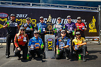 Sep 17, 2017; Concord, NC, USA; NHRA funny car drivers (front row from left) Courtney Force , Ron Capps , Robert Hight , J.R. Todd (back row from left) Matt Hagan , John Force , Tommy Johnson Jr , Tim Wilkerson , Jack Beckman and Cruz Pedregon pose for a group photo as the drivers in the Countdown to the Championship during the Carolina Nationals at zMax Dragway. Mandatory Credit: Mark J. Rebilas-USA TODAY Sports