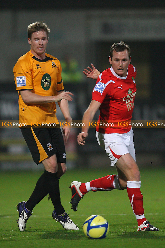 Michael Gash of Cambridge United and Joe Clarke of Wrexham - Cambridge United vs Wrexham - FA Cup 1st Round Football at The R Costings Abbey Stadium, Cambridge - 11/11/11 - MANDATORY CREDIT: Gavin Ellis/TGSPHOTO - Self billing applies where appropriate - 0845 094 6026 - contact@tgsphoto.co.uk - NO UNPAID USE.