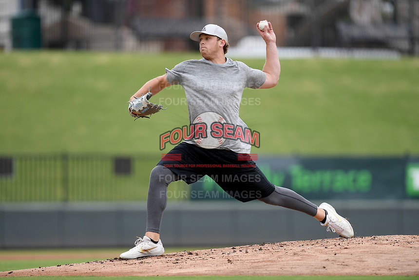 Chicago White Sox minor leaguer John Parke delivers a pitch during an informal workout with Major League and Minor League players from around the region on Tuesday, June 16, 2020, at Fluor Field at the West End in Greenville, South Carolina. Team workouts have been shut down during the coronavirus pandemic, so this group began working out in game situation simulations a couple of days a week. (Tom Priddy/Four Seam Images)