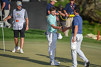 Rory McIlroy (NIR) shakes hands with Matt Fitzpatrick (ENG)on the green on 18 following round 4 of the Arnold Palmer Invitational at Bay Hill Golf Club, Bay Hill, Florida. 3/10/2019.<br /> Picture: Golffile | Ken Murray<br /> <br /> <br /> All photo usage must carry mandatory copyright credit (© Golffile | Ken Murray)