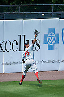 Pawtucket Red Sox outfielder Carlos Peguero (45) catches a fly ball during a game against the Syracuse Chiefs on July 6, 2015 at NBT Bank Stadium in Syracuse, New York.  Syracuse defeated Pawtucket 3-2.  (Mike Janes/Four Seam Images)