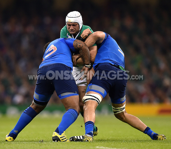 Rory Best of Ireland is double-tackled. Rugby World Cup Pool D match between France and Ireland on October 11, 2015 at the Millennium Stadium in Cardiff, Wales. Photo by: Patrick Khachfe / Onside Images