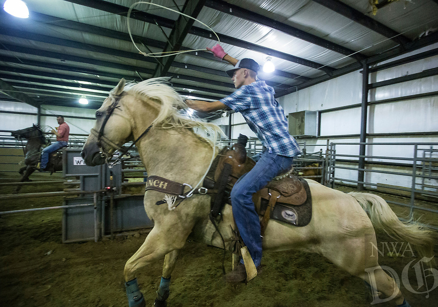 NWA Democrat-Gazette/BEN GOFF @NWABENGOFF<br /> Steven Hull of Seymour, Mo. competes Thursday, Aug. 8, 2019, during the team roping event during Benton County Fair in Bentonville.