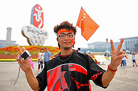 Aug. 6, 2008; Beijing, CHINA; A Chinese fan poses for a photo in Tiananmen Square in Beijing. The Olympics begin at 8pm on August 8, 2008. Mandatory Credit: Mark J. Rebilas-