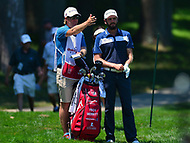 Potomac, MD - June 30, 2017: Troy Merritt and his caddie, Scott Sajtinac, discuss the 10th hole during Round 2 of professional play at the Quicken Loans National Tournament at TPC Potomac at Avenel Farm in Potomac, MD, June 30, 2017.  (Photo by Don Baxter/Media Images International)