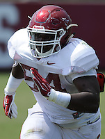 NWA Democrat-Gazette/ANDY SHUPE<br /> Arkansas defensive lineman TlJ. Smith takes part in a drill Thursday, Aug. 13, 2015, during practice at the university practice field in Fayetteville.