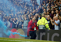 A steward removes a flare from the pitch<br /> <br /> Photographer Rich Linley/CameraSport<br /> <br /> UEFA Champions League - Quarter-finals 2nd Leg - Manchester City v Tottenham Hotspur - Wednesday April 17th 2019 - The Etihad - Manchester<br />  <br /> World Copyright © 2018 CameraSport. All rights reserved. 43 Linden Ave. Countesthorpe. Leicester. England. LE8 5PG - Tel: +44 (0) 116 277 4147 - admin@camerasport.com - www.camerasport.com