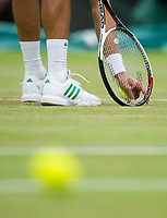 Novak Djokovic (2) of Serbia checking the damage to the grass court during his Men's Singles Fourth Round Match today against Adrian Mannarino of France<br /> <br /> Photographer Ashley Western/CameraSport<br /> <br /> Wimbledon Lawn Tennis Championships - Day 8 - Tuesday 11th July 2017 -  All England Lawn Tennis and Croquet Club - Wimbledon - London - England<br /> <br /> World Copyright &not;&copy; 2017 CameraSport. All rights reserved. 43 Linden Ave. Countesthorpe. Leicester. England. LE8 5PG - Tel: +44 (0) 116 277 4147 - admin@camerasport.com - www.camerasport.com