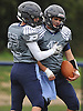 Plainview JFK running back No. 15 Nico Mueller, right, gets congratulated by teammate No. 22 CJ Mazzocchi after rushing for a touchdown in the first quarter of a Nassau County Conference I varsity football game against Port Washington at Plainview JFK High School on Saturday, October 3, 2015. Mueller ran for four touchdowns in the first half to lead the Hawks to a 42-0 win.<br /> <br /> James Escher