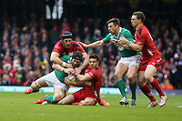 Pictured: Sean O'Brien of Ireland (2nd L) is brought down by Luke Charteris (L) and Rhys Webb (3rd L) of Wales Saturday 14 March 2015<br />
