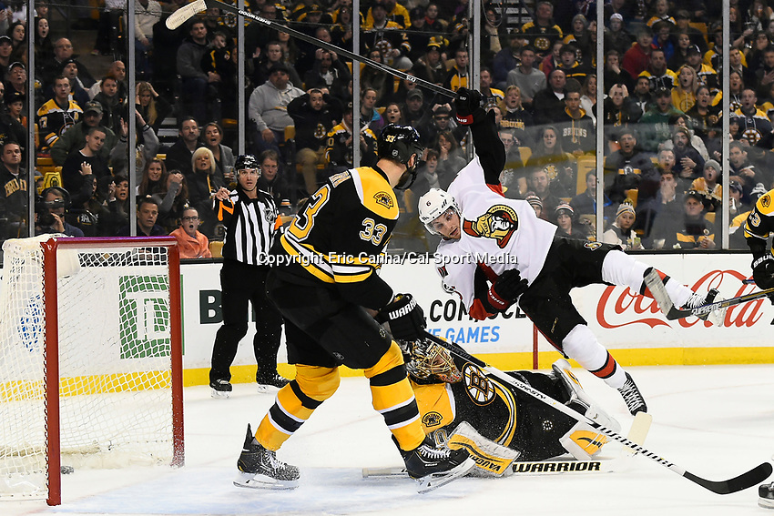 January 3, 2015 - Boston, Massachusetts, U.S. - Ottawa Senators right wing Bobby Ryan (6) flips over Boston Bruins goalie Tuukka Rask (40) as he makes the game winning goal in overtime at the NHL game between the Ottawa Senators and the Boston Bruins held at TD Garden in Boston Massachusetts. The Bruins in overtime to the Senators 3-2. Eric Canha/CSM
