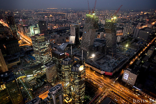 An overview of Beijing, which is getting ready to host the 2008 Olympics. The slanting buildings are the new CCTV Tower, designed by Dutch architect Rem Koolhaas.