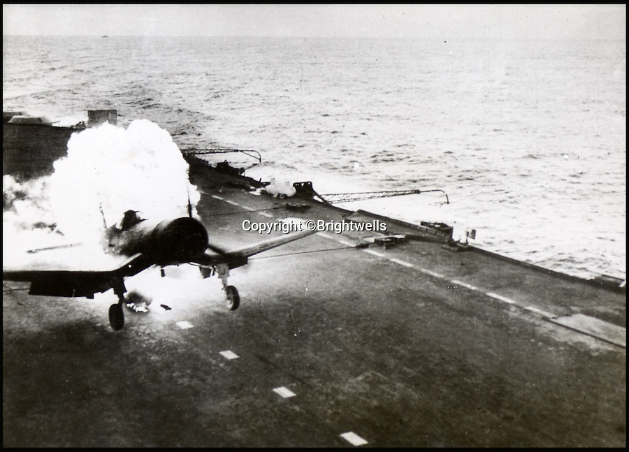 BNPS.co.uk (01202 558833)<br /> Pic: Brightwells/BNPS<br /> <br /> A Corsair plane bursts into flames on landing.<br /> <br /> A remarkable photo album showing the brutal aftermath of Kamikaze attacks and crash landings on Allied aircraft carriers in the Second World War has been uncovered after 70 years.<br /> <br /> The 112 original photographs of the Royal Navy Pacific Fleet in 1945 include a host of images showing the flaming wreckage of Japanese planes that were deliberately flown into the superstructure of ships by suicidal pilots.<br /> <br /> There are also harrowing photos of US fighter planes bursting into flames on landing on the flight deck as well as one crashing into the sea.<br /> <br /> The album is being sold by Brightwells Auctioneers in Herefordshire.