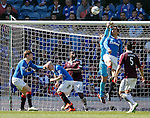 Belil Mohsni heads the ball out of Cammy Bell's gloves