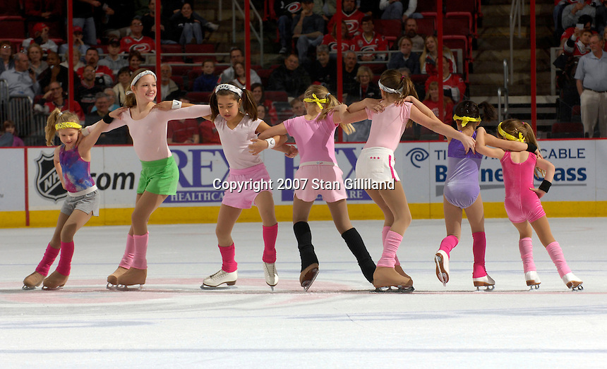 """Raleigh Reczone figure skaters skate their """"Let's Get Physical"""" routine during an intermission of a Carolina Hurricanes vs. New Jersey Devils hocke game Thursday, March 15, 2007 at the RBC Center in Raleigh, NC. New Jersey won 3-2."""