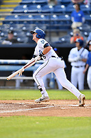 Asheville Tourists left fielder Will Golsan (8) swings at a pitch during game one of a double header against the Charleston RiverDogs at McCormick Field on April 9, 2019 in Asheville, North Carolina. The Tourists defeated the RiverDogs 17-3. (Tony Farlow/Four Seam Images)