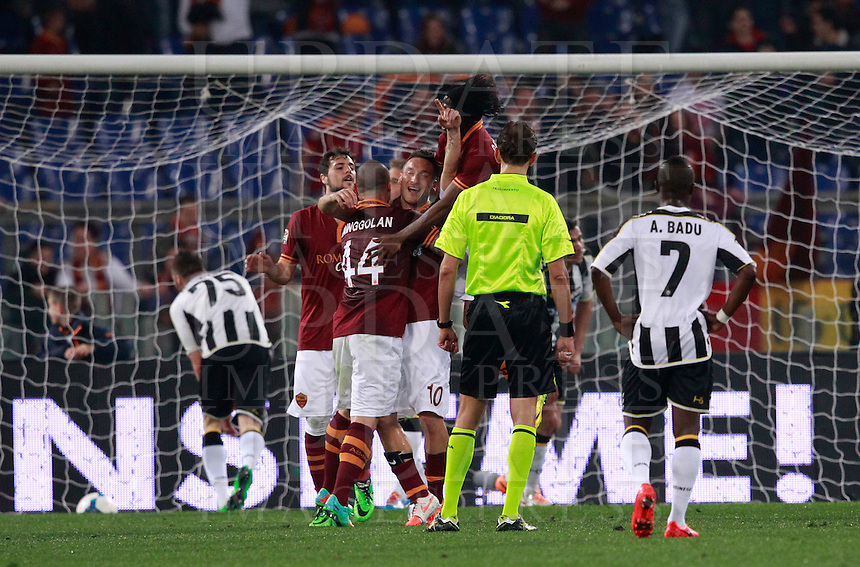Calcio, Serie A: Roma vs Udinese. Roma, stadio Olimpico, 17 marzo 2014.<br /> AS Roma forward Francesco Totti, center, celebrates with teammates after scoring during the Italian Serie A football match between AS Roma and Udinese at Rome's Olympic stadium, 17 March 2014.<br /> UPDATE IMAGES PRESS/Isabella Bonotto