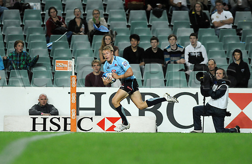 17.03.2012 Sydney, Australia.Waratahs winger Tom Kingston scores a try during the FxPro Super Rugby game between the New South Wales Waratahs  and Western Force at the Allianz Stadium,Sydney..